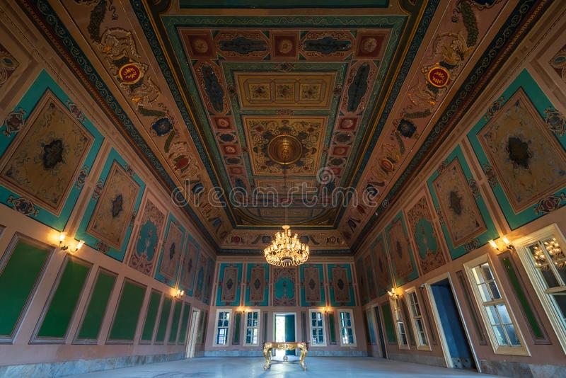 Royal era historic Manasterly Palace with decorated ceiling abd big chandelier, Cairo, Egypt stock photos