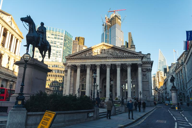 Royal Exchange with the statue of the Duke of Wellington at the front royalty free stock photos