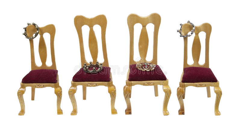 Royal Family. Shown by wooden thrones with velvet seats with a variety of crowns - path included stock photography