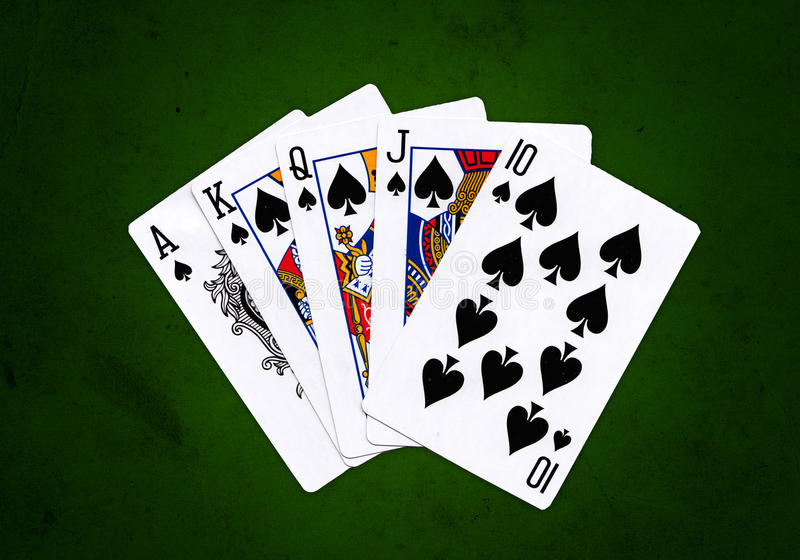 Royal Flush. Of Spades over a green grungy background stock images