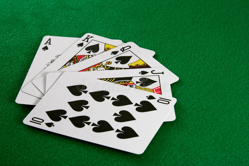Royal Flush. With spades on green table royalty free stock photos