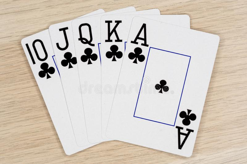Royal flush clubs - casino playing poker cards stock images