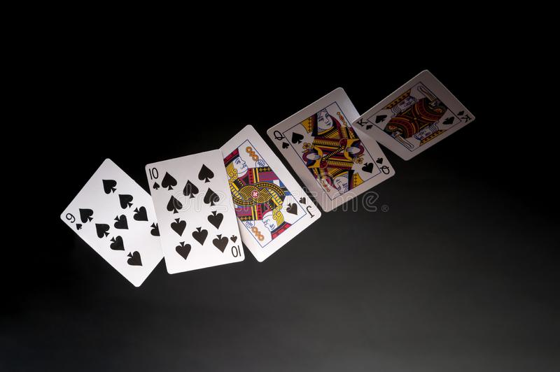 Royal Flush. Flying playing cards on a dark background - Royal Flush royalty free stock photography