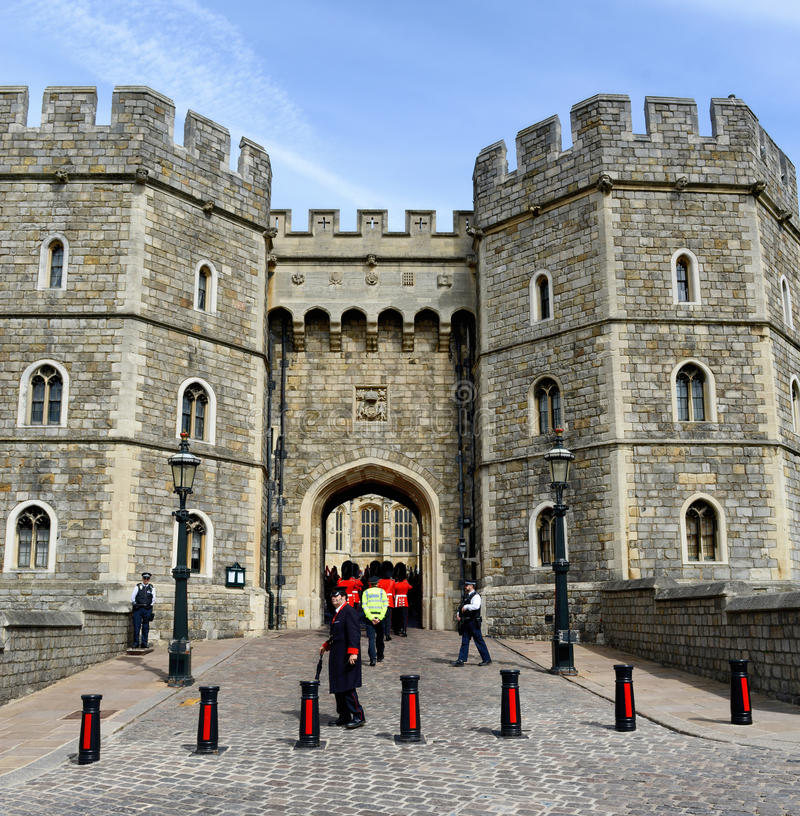 Royal Guards Passing Through Windsor Castle Gate stock photo