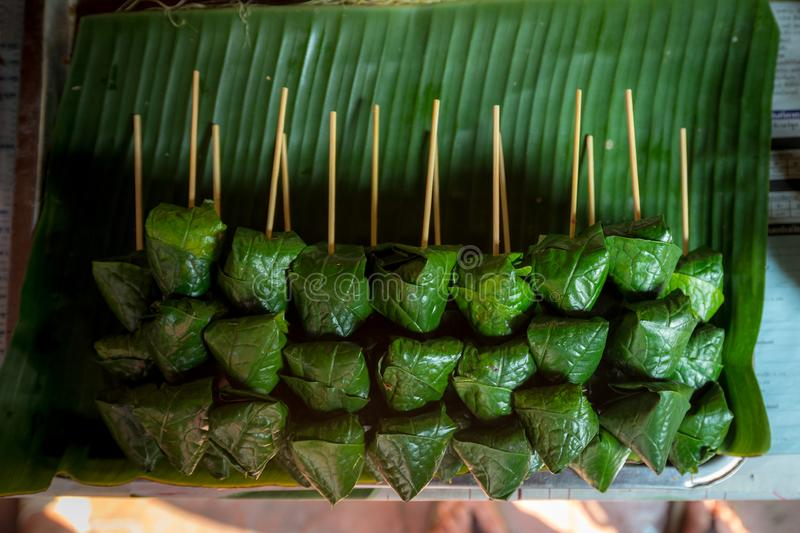 A Royal Leaf wrap Appetizer Miang Kham in the stick royalty free stock photos