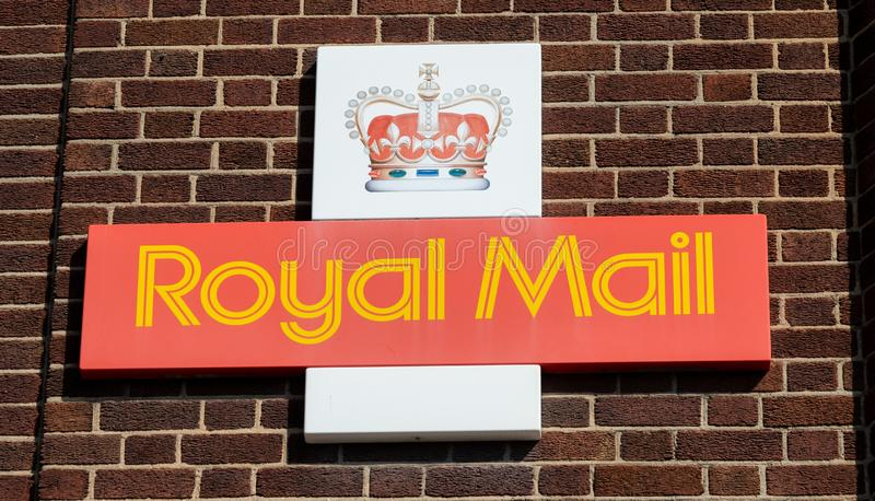 Royal Mail logo with crown mounted on the brick wall of a sorting office Widnes April 2019 stock photo