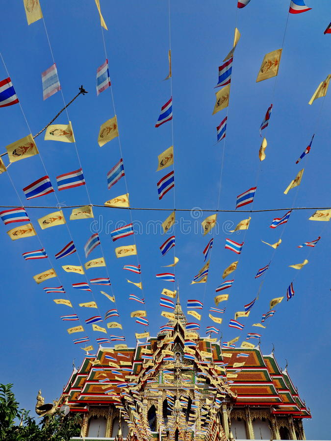 Royal and national flags of Thailand waving in blue sky stock photos