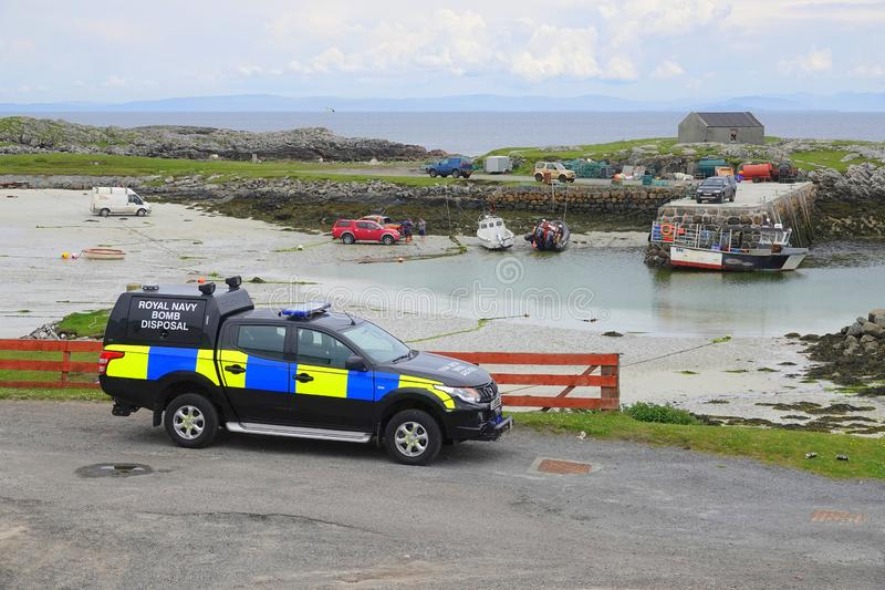 Royal Navy bomb disposal vehicle. A Royal Navy bomb disposal vehicle parked by Scarinish harbour on the island of Tiree in Scotland stock photos