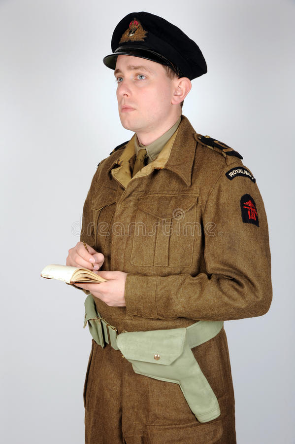 Royal Navy Commando WWII. Reconstruction of a WWII period officer of the Royal Navy beach unit dressed for service with combined operations Commandos. Original royalty free stock image