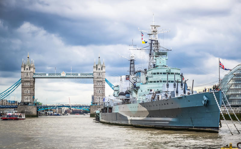 Royal Navy Cruiser HMS Belfast Moored in Thames with Tower Bridge in Background, London, England. Royal Navy Cruiser HMS Belfast Moored in Thames with Tower royalty free stock photography