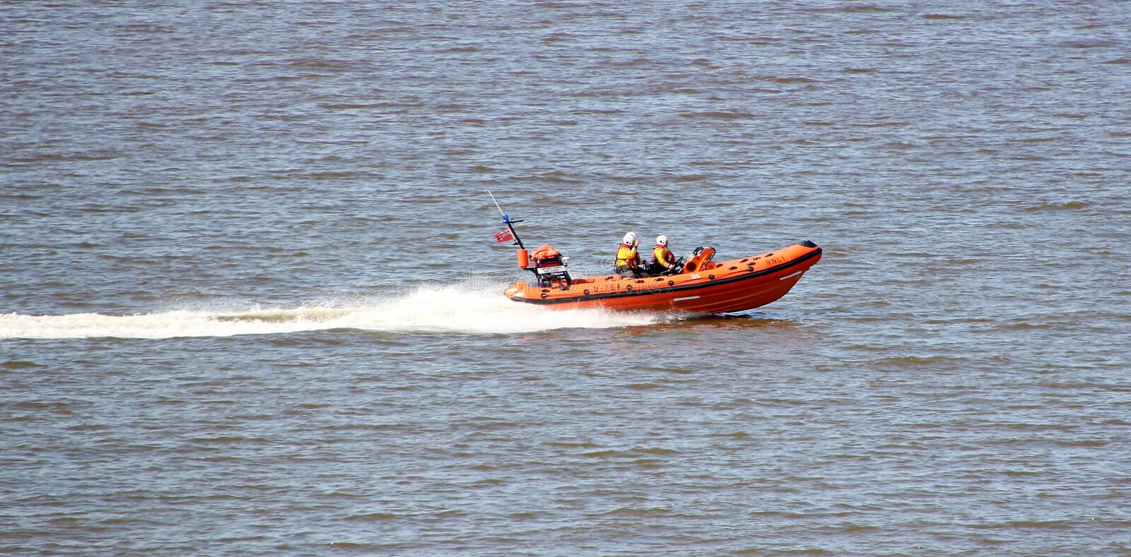 Royal navy lifeboat sea rescue. Photo of the royal navy lifeboat sea crew on on a search and rescue mission at whitstable bay in kent. photo ideal for rescue stock image