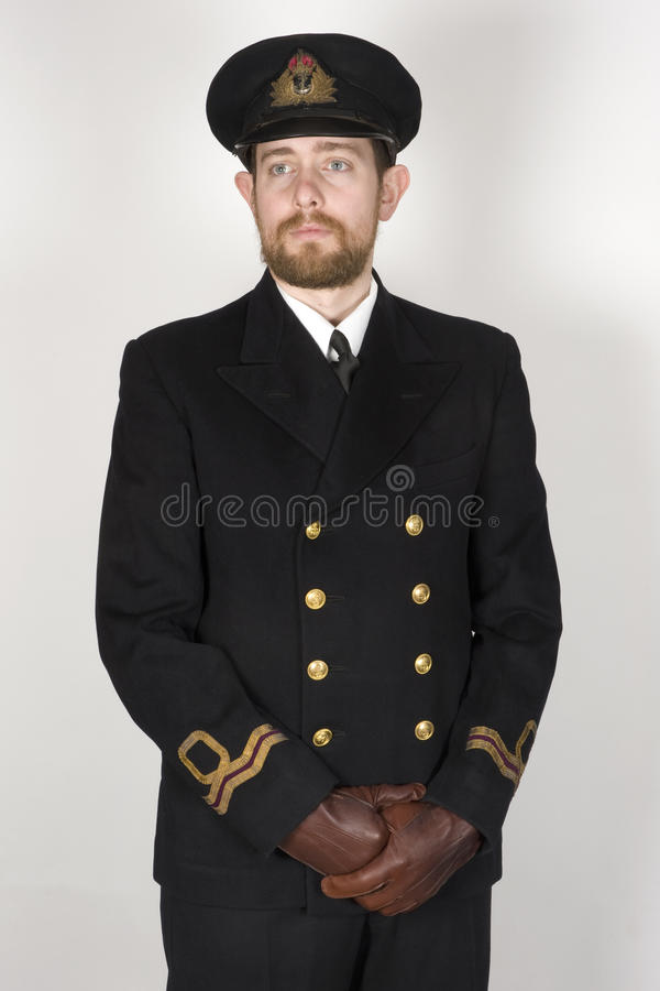 Royal Navy Volunteer Reserve Officer sailor WWII. Reconstruction of a WWII period RNVR Lieutenant sailor of the Royal Navy. Original period clothing. Dressed as stock photography