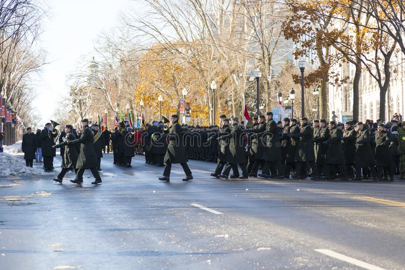 Royal 22nd Regiment soldiers marching at the music of their band during the Remembrance Day Ceremony. Grande-Allée street, Quebec City, Quebec, Canada royalty free stock image