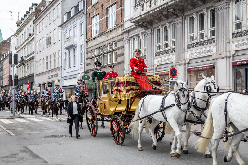 Royal New Year Celebration in Copenhagen, Denmark. Copenhagen, Denmark - January 04, 2017: Queen Margrethe in her 24-carat golden coach is escorted by the Guard royalty free stock images