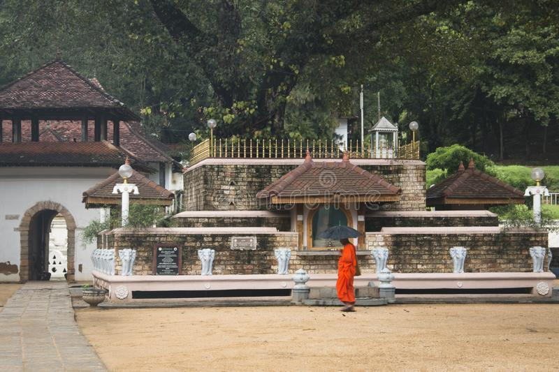 Royal palace complex in Kandy, Sri Lanka. KANDY, SRI LANKA - DECEMBER 2017: Monk at the Royal Palace complex in Kandy in Sri Lanka which also contains the temple stock images