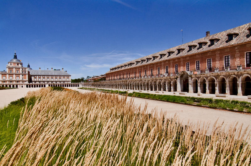 Royal Palace historical square and buildings in Aranjuez, Spain. With high grass in front royalty free stock image