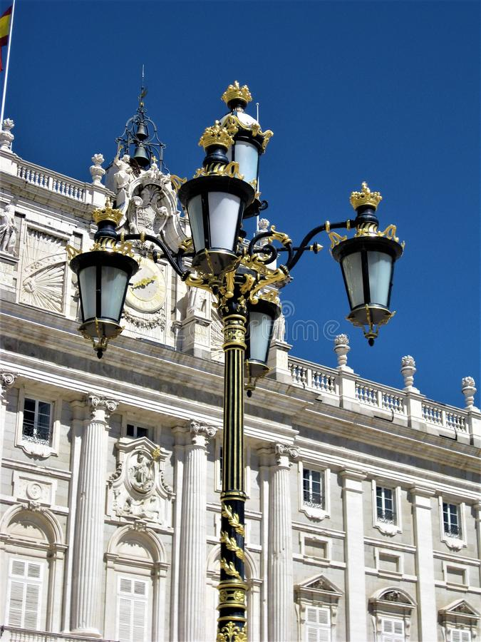 Royal palace Madrid with beautiful street lamp stock photos