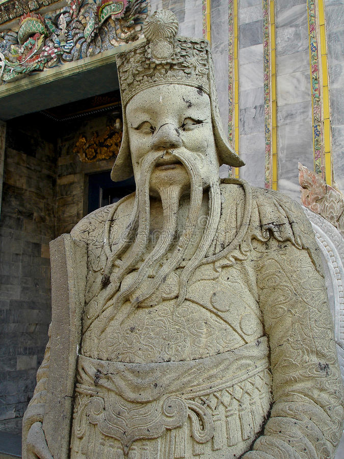 Royal Palace - Stone guard with flowing beard stock image