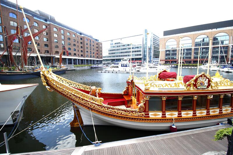 The Royal Rowbarge Gloriana, moored in St Katherines Dock near Tower Bridge, London City stock images