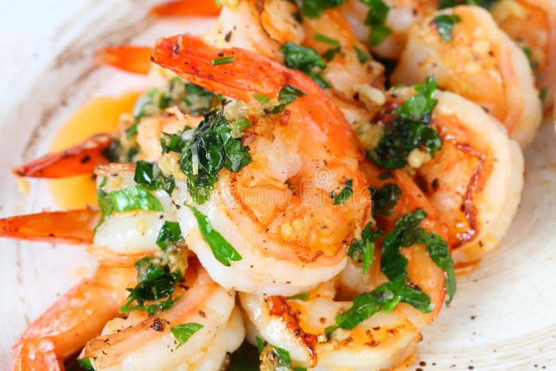 Royal shrimp with garlic and herbs. King prawns royalty free stock images