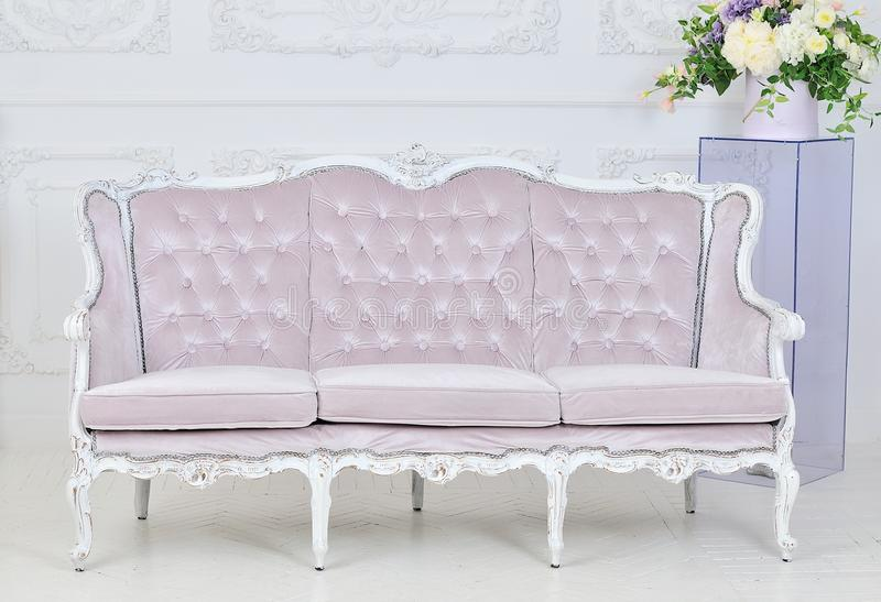 Royal sofa in luxurious interior stock photography