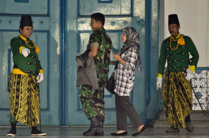 ROYAL SURAKARTA MUSIC CORPSE. Royal Guards of Surakarta Kingdom are seen talking to tourist, at Surakarta Royal Palace, Java, Indonesia. Once part of Surakarta stock photo