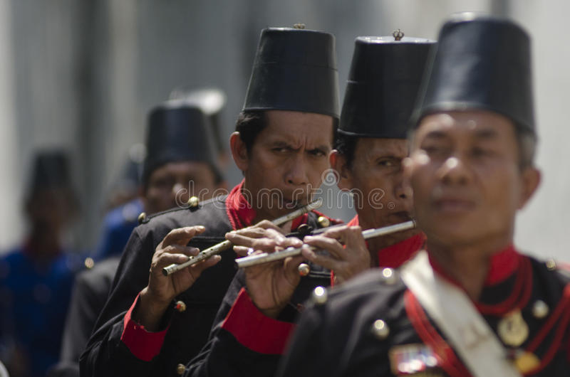 ROYAL SURAKARTA MUSIC CORPSE. The music corpse of Royal Surakarta Palace is seen rehearsing at the street of Solo, Java, Indonesia. Once part of Surakarta Royal stock photos