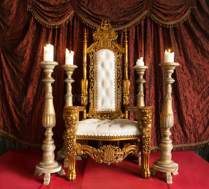 Royal throne of gold on red curtain background. Indoor. Royal throne of gold on red curtain background stock photo