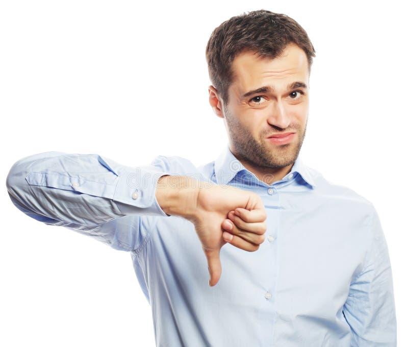 Rozczarowany młody biznesowy mężczyzna z kciuka puszkiem fotografia stock