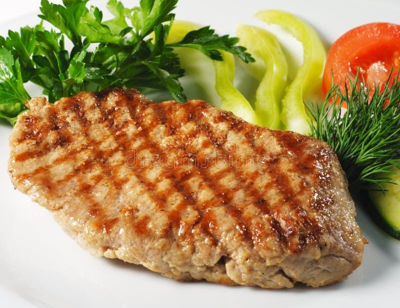 rozdaje wieprzowina gorącego mięsnego stek obrazy royalty free