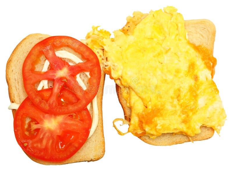 Rozdrapany jajko i Serowa kanapka Nad bielem fotografia stock
