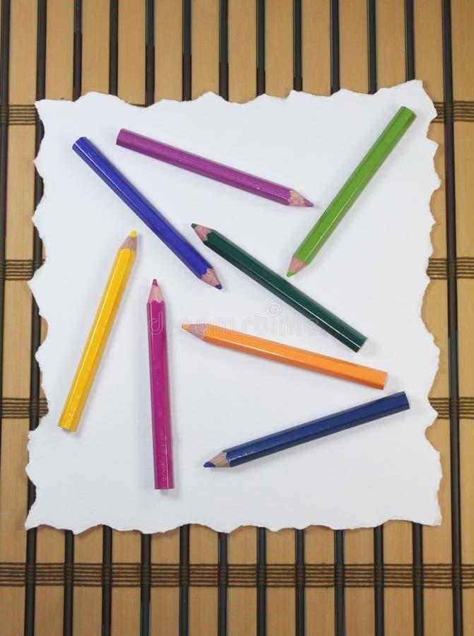 Rozdzierający papier z ołówkami obraz royalty free