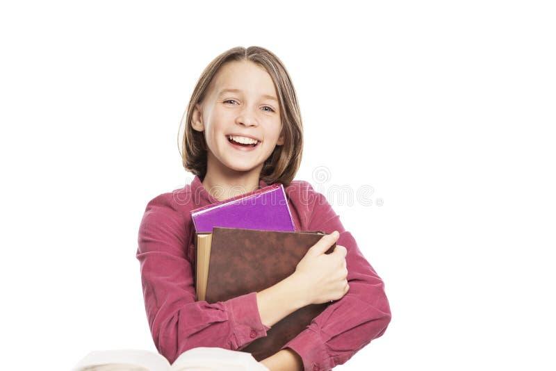 Roześmiana nastoletnia dziewczyna z książkami obrazy royalty free