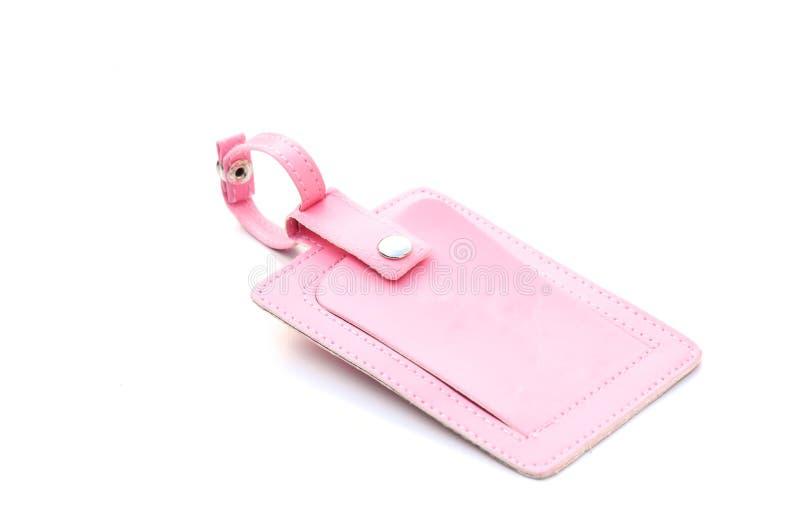 Roze bagageetiket stock afbeeldingen