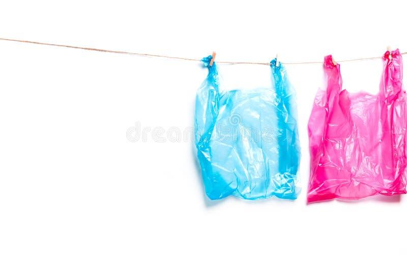 Roze, blauwe plastic zak Ecologisch concept verontreiniging van ecologie royalty-vrije stock foto