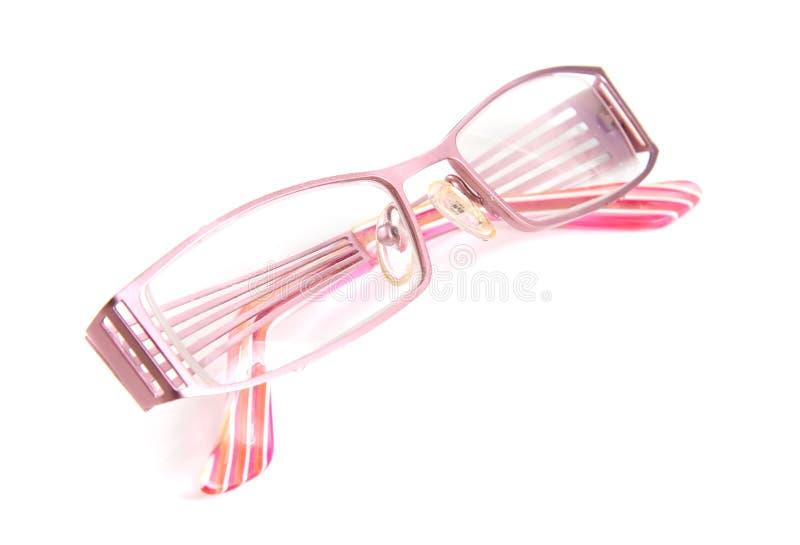 Roze bril op witte achtergrond royalty-vrije stock foto's