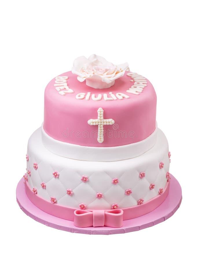 Roze cake op twee niveaus voor doopselmeisje Witte achtergrond royalty-vrije stock afbeelding