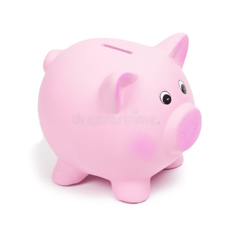 Roze ceramisch geïsoleerd spaarvarken, op witte achtergrond stock afbeelding