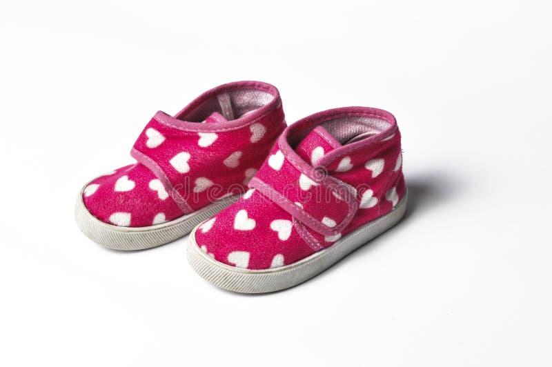 Roze children' s tennisschoenen op een witte achtergrond worden ge?soleerd die Children' s schoenen Schoenen voor meisj royalty-vrije stock foto's