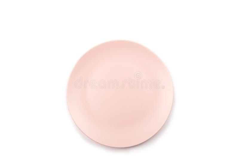 Roze die plaat op wit wordt geïsoleerd stock foto