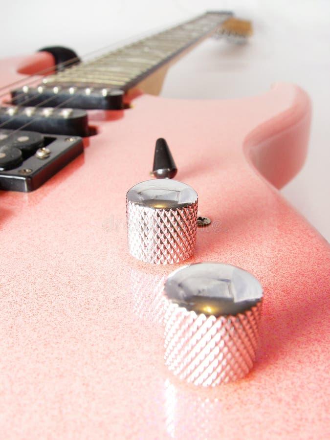 Roze elektrische gitaar stock afbeelding