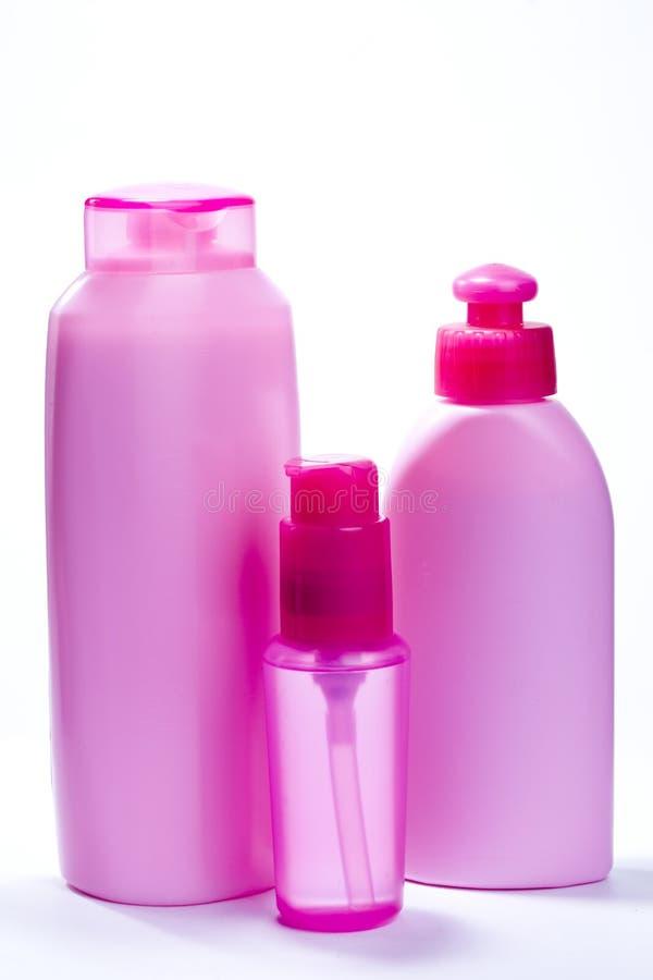 Roze flessen voor schoonheidsmiddelen royalty-vrije stock afbeelding