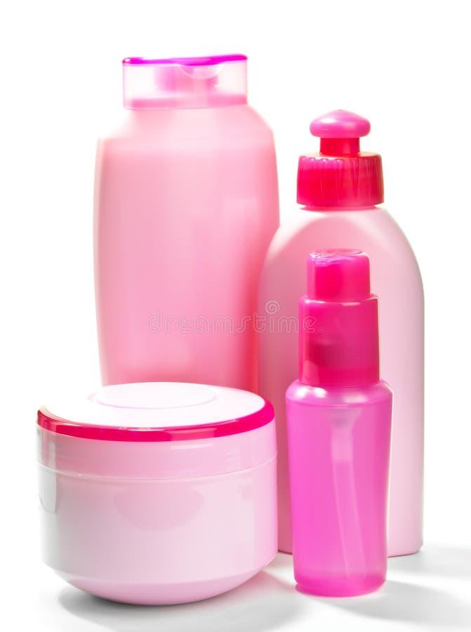 Roze flessen voor schoonheidsmiddelen royalty-vrije stock foto's