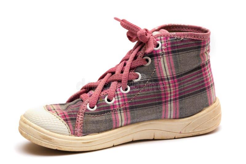 Roze geruit Schots wollen stof gumshoes stock fotografie
