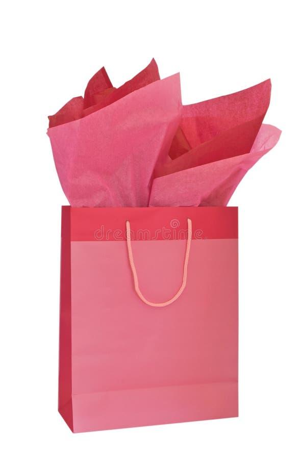 Roze giftzak met weefsel stock fotografie