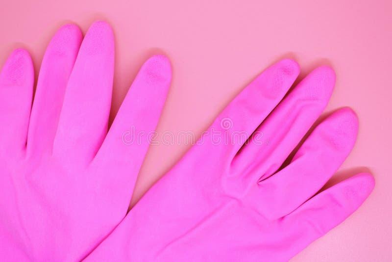Roze handschoenenclose-up op roze achtergrond, royalty-vrije stock foto's