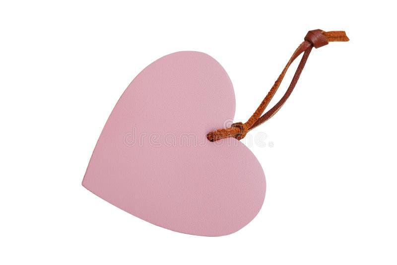 Roze hart gevormd leerprijskaartje met leer koord geïsoleerd o stock foto's