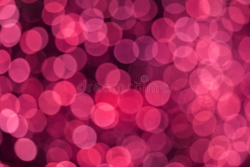 roze kleurensamenvatting van onduidelijk beeld en bokeh kleurrijke licht en nachttuin stock fotografie