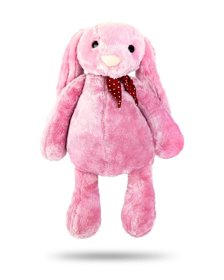 Roze konijnpop met afluisteraar die op witte achtergrond wordt geïsoleerd Leuk gevuld dierlijk en pluizig bont voor jonge geitjes royalty-vrije stock foto