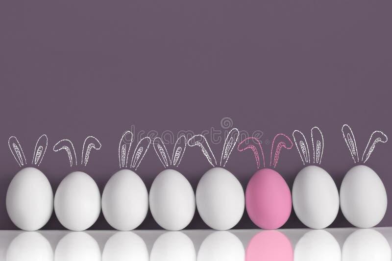 Roze konijntje onder witte konijnen als paaseieren royalty-vrije stock afbeeldingen